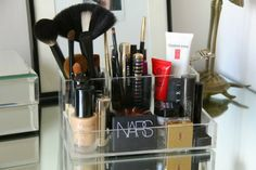 a great idea for getting rid of my (three!) makeup bags ... heading to the container store after work