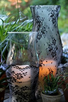 Halloween Centerpiece Idea: Black Lace Lanterns And Spiny Succulents --> http://www.hgtvgardens.com/crafts/diy-halloween-decorations-black-widow-lamp-centerpiece?soc=pinterest