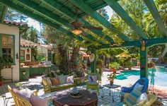 Annie Potts' sunny terrace includes a dining area, a covered loggia, a complete outdoor kitchen and a magnificent resort-style pool