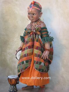 "The ""Maasai Dancer"" from East Africa. Porcelain doll. The head has painted hair. Renowned for their rich culture of traditional dancing and bead work. by Susan Krey"