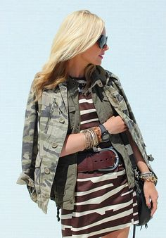 camo + military + large graphic print - I doubt many women could carry it off. But If you are going to give it a try - clean up the lines - the bangles and necklaces should disappear - The sunglasses and bag look good - footwear should be nude or neutral & hardly noticeable.  I think this would work better with the two jackets & a simple, black dress