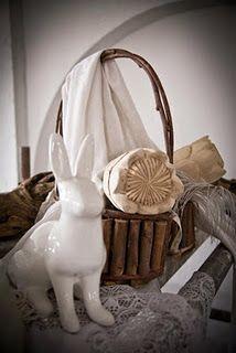 white bunny. wooden proteas. pretty