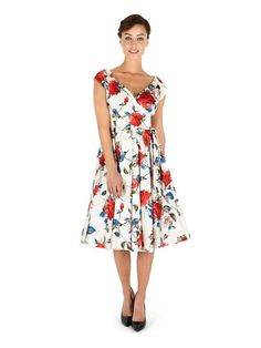 This stunning floral dress from The Pretty Dress Company has a been beautifully designed with a striking red and blue seville print, voluminous circle skirt and has a perfectly cut hourglass bodice. Product Name: Carmen Hourglass Swing Cream.  View more occasion wear items from our Pretty Dress Company collection at: https://shop.baroqueboutique.co.uk/         Photographs courtesy of:  http://www.theprettydresscompany.com/
