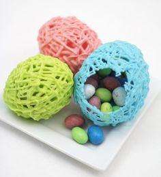 Many years ago, I remember making some hollow eggs with yarn and glue - similar to a piñata. And then I saw a tutorial  for it a few mon...
