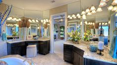 Find this master bath at Avalon in #Sugarland! Feel beautiful in your bathroom by decorating with #mirrors, #flowers, and sparkling lights!