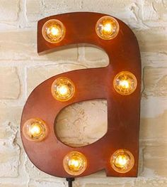 Fun initial sconce for a kid's bedroom!