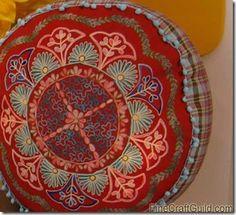 A Zafu meditation pillow . For instructions : http://www.finecraftguild.com/how-to-zafu-meditation-pillow/