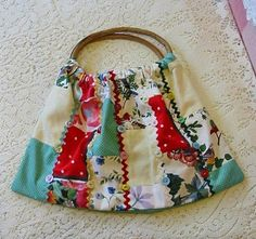 Pretty PATCHWORK CASUAL PURSE Vintage Tablecloths and Feedsack, Birds, Flowers, Rick Rack, Bamboo Handles, Old Buttons. $26.95, via Etsy.