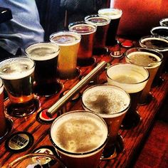 Russian River Brewing Company in Santa Rosa, CA (2015) I'll take the food over the beer but definitely the coolest flight you'll ever have