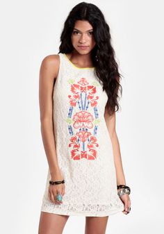 this inspires me ... stencil FOLK FLOWERS on a lace dress, shirt, shorts, or skirt