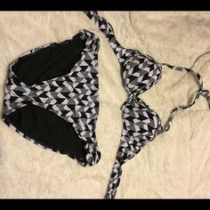 Two piece swim suit Bought new at JcPenneys and wore a couple of times. It does have the push up in the top of the suit. One side of the top has a little light pink discolor. No snags or stretched out. In great condition. The top is med and the bottom is large. jcpenney Swim Bikinis