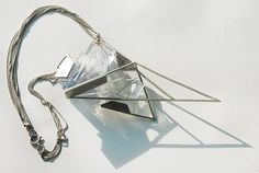 Marieken Meeuwssen. Necklace. Sterling silver 925, 3D printed nylon (stereolythography), stainless steel bolts.