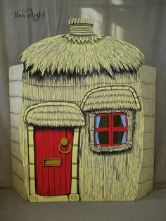 The house of straw, made with cardboard, wooden frame and acrylic paints. El cerdito se esconde detrás a esperar al lobo :)