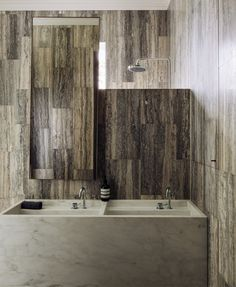 Travertine tiles and carrara marble sink bathroom   Fearon Hay Architecture