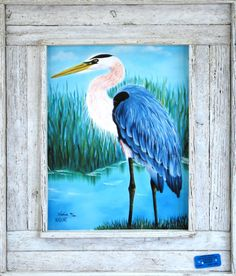 "This is one of several Great Blue Heron paintings by Nadine from Lobster Trap Art. ""Big Blue"" is one of her favorites! The detail on the bird is fabulous! The print comes in one a double slat window box frame with a white wash finish. Made from an authentic lobster trap there is a lobster trap certificate on the face of the frame. $129.00 www.lobstertrapart.com/index.php?id_product=158&controller=product&id_lang=1"