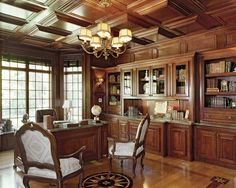 MDK Designs Associates, melanie@mdkdesigns.com. Library and office, Custom woodwork, medallion floors with copper insert. Custom built desk, marble counter tops, reverse coffer ceilings all mahogany.