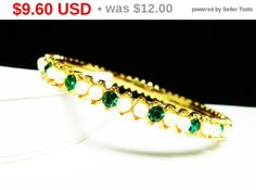 New Listings Daily - Follow Us for UpDates -  Summer Sizzler Sale Style:  #Vintage #Rhinestone & Bead Bangle Bracelet -  one green rhinestones and two white pearlescent beads in a goldtone setting.  It's a great retro st... #vintage #jewelry #teamlove #etsyretwt #ecochic #thejewelseeker #rhinestone ➡️ http://etsy.me/2rRqAxV