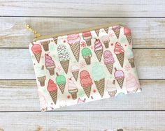 A personal favorite from my Etsy shop https://www.etsy.com/listing/481907007/ice-cream-scoops-zipper-pouch-gold