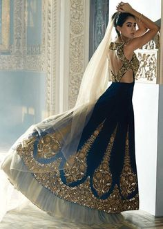 Say who you're without speaking a thing with this navy blue velvet lehenga. Featuring intricate stone, zircon, zari and kundan work, this lehenga is perfect for that dreamy bridal look. Indian Attire, Indian Wear, Moda India, Style Indien, Indian Couture, Indian Designer Wear, Bollywood Fashion, Bollywood Saree, Indian Sarees