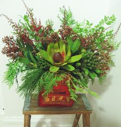 Holiday flower arrangement in vintage tea tin