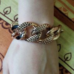 """Chunky Bracelet Cute gold colored bracelet. It is very cute. Made out of plastic so it is lightweight. U wouldn't know it is plastic until u touch it. New in package. This can clasp anywhere from 7 1/2"""" to 10 1/2"""" Jewelry Bracelets"""