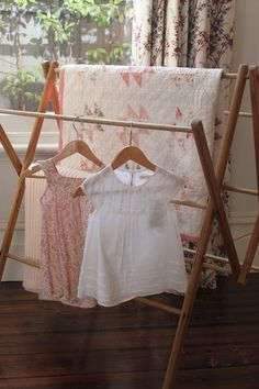 A drying rack and wooden hangers for these sweet little dresses.