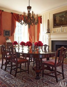 In the dining room are 19th-century chairs, a circa-1900 table, and curtains of a Jim Thompson silk.