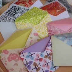Envelopes made out of scrapbook paper/wallpaper samples, and can also be made out of maps