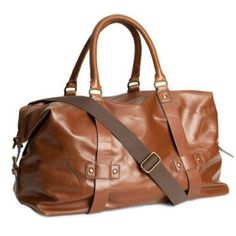 Weekender Bag Faux leather weekender bag with double handles and detachable, adjustable shoulder strap. Top zip and two smaller inner compartments. Lined. Size 13 3/4 x 19 3/4 in. Shows signs of wear but gives it a great vintage look. H&M Bags Travel Bags