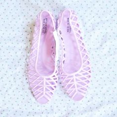 American Apparel Jelly Flats NWT Lilac Flat Lattice Jelly Sandals from American Apparel. These are a US Size 9. I love these shoes and I own several pairs of them - I'm just trying to downsize my shoe collection right now. Check out my other listings for more American Apparel. NO TRADES, TRY ONS, OR HOLDS. American Apparel Shoes Flats & Loafers