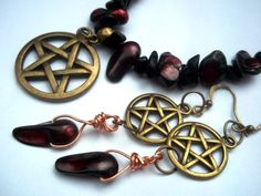 Make a dramatic statement with this elegant set. Rich colors, and the bronze pendants always make me think vintage inspired.  Dark blood red pearls, black onyx and heavy bronze pentacle.  You get both the necklace and the earrings shown in the photo's. The necklace is a large bronze pentacle, 1 i...