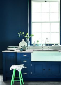 Take the radical approach to your kitchen and paint walls and furniture the same deep colour to add drama. Get more interiors inspiration at http://www.redonline.co.uk