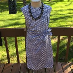 """Ann Taylor (not factory) dress. Navy blue ( maybe black to some?) geometric print on white. Lovely side tie with rouching is so slimming. Fully lined. Hidden back zip. No flaws or piling. 38"""" from shoulder to hemline. 18"""" from armpit to armpit. 16"""" flat across the front at waist. 96% cotton 4% spandex. Perfect summer work/fun dress. Ann Taylor Dresses"""