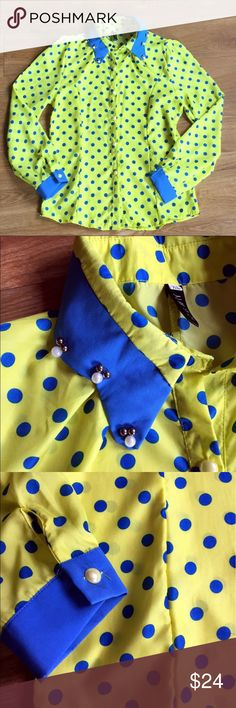 "Yellow and Blue Polka Dot Blouse This bright blouse is sure to bring sunshine to your day! Bright yellow with blue polka dots, collar and cuffs. It's has a cute beaded detail on the collar. L: 24.5"" pit-to-pit: 18"". Excellent condition. No trades please :) Tops Blouses"