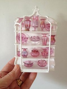 Amazing shelf filled with rose glass ornaments. It was for sale, it's been sold to some lucky collector. It's 1/12 scale.