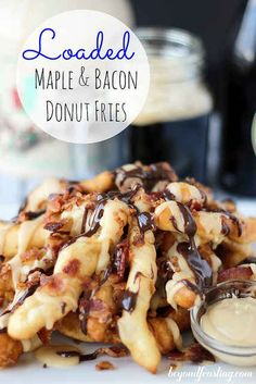 Quick and easy donut french fries topped with a maple glaze, chocolate sauce and bacon. Just like a maple bar donut but better! Plus it's totally acceptable to eat more than one! Köstliche Desserts, Delicious Desserts, Dessert Recipes, Yummy Food, Yummy Eats, Dessert Ideas, Snack Recipes, Maple Bacon Donut, Donut Recipes