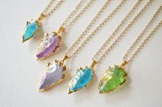 *** Beautiful, Delicate and Trendy Crystal Arrowhead Necklace ***      This lovely Gold Plated Necklace is made with Natural Titanium Quartz Stone, which has a gorgeous iridescent effect that reflects a variety of pretty colors when gets light, rimmed with 24k electroplated Gold.    Customize to the size and color you like just make sure to select the desired length from the drop down menu.      *** For reference to choose the options use the first picture and in order from left to right…