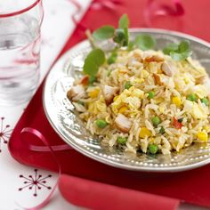 """Leftover rice gets a fun and healthy upgrade with Annabel Karmel's egg fried rice. She says adding chicken, prawns, and vegetables to it """"makes a complete meal, and this is a great, quick supper to throw together for all the family — and a great one for using leftovers. It's fun to serve chicken rice in a bowl with some child-friendly chopsticks."""" Source: LilSugar"""