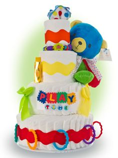 Playtime Bear 4 tier diaper cake has a wonderful, bright and cheery bear ready to have hours and hours of fun with the little one. Baby Nappy Cakes, Diaper Cake Boy, Diaper Cakes, Baby Shower Cakes, Baby Shower Gifts, Baby Gifts, January Baby, Gift Cake, Unique Baby