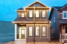 Take a photo tour of Broadview Homes. We unite a contemporary building philosophy & essential design considerations to create luxurious modern living. Contemporary Building, New Home Communities, New Home Builders, How To Take Photos, Calgary, Photo Galleries, New Homes, House Design, Aberdeen