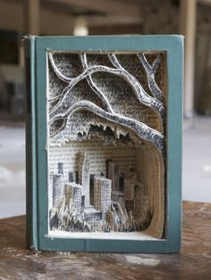 Book Art By Jonathan Wiley, A Tree Grows In Brooklyn. Make meeeee book art! A type of sculpture formed from a background. There are 3 different kinds of relief sculptures: low, high, and sunken. Ancient Relief Sculpture During the civilizations. This Is A Book, Up Book, Book Crafts, Paper Crafts, Tree Grows In Brooklyn, Altered Book Art, Book Folding, Book Projects, Cool Art Projects