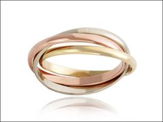 Russian wedding ring, in three colours of gold, yellow, white and rose.