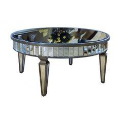 Оригинальный круглый журнальный столик с зеркальной столешницей, декорированной по царге стеклянными вставками, на деревянных ножках.