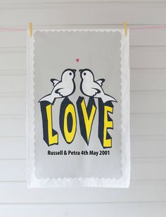 A unique personalised T-towel that can celebrate any occasionIf you would like to send the gift direct to the recipient we have a gift wrap option for an extra £1.50.The note will be hand writtenAvailable in our new grey print with a nice punchy yellow 'love' With a strong Love theme though why not give the T-towel as a wedding gift ,anniversary present or for someone special in your life. ( cotton is for a 2nd wedding anniversary!) The recipient might even decide that its too special to use…