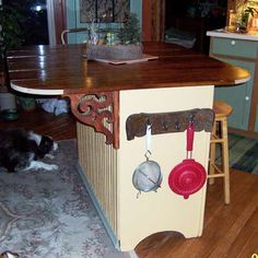 This Old House magazine reader's ideas 2010.  Use an old dress as a kitchen island.  Great idea!