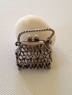 925 Sterling Silver Charm...handbag opens.weight as shown on scale 5.2g
