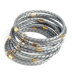 Be trendy with this fashion leather bracelet from the Israeli fashion jewelry designer Hagar Satat. This bangles bracelet is made of multiple braided leather hoops with 24K gold plated metal links to create a unique fashion Jewelry.