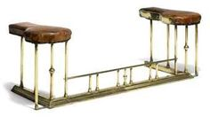 AN EDWARDIAN BRASS CLUB FENDER EARLY 20TH CENTURY With embossed tan leather seats above plain supports 62 in. (157.5 cm.) wide Furniture, Home Living Room, Brass Living Room, Hearth, Rustic Country, Leather Seat, Bar Stools, Home And Living, Window Seat