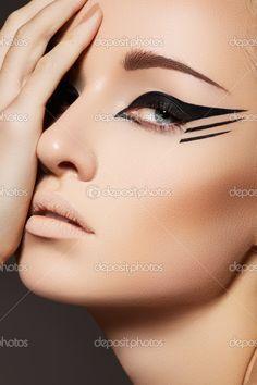 Stock Photo: Glamourous closeup female portrait. Fashion eyeliner ...