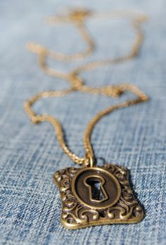 """It's often the last key in the bunch that opens the lock.""  This is a brass necklace with a vintage lock as the pendant. The chain is 22 inches with a lobster clasp.  To view all available jewelry, click here: https://www.etsy.com/shop/CrystalCharriere?section_id=14535807"